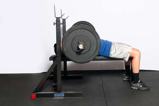 Continue to lower the bar until it lightly touches your chest. It should not hit your chest or bounce off it.