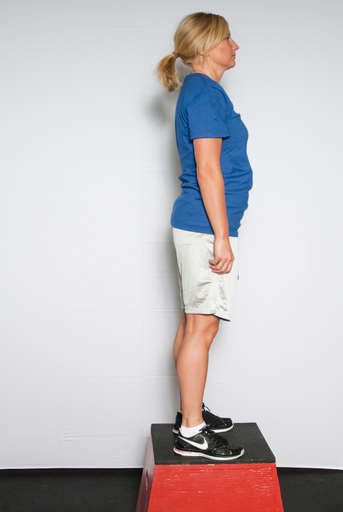Straighten your legs completely to stand up on the box.