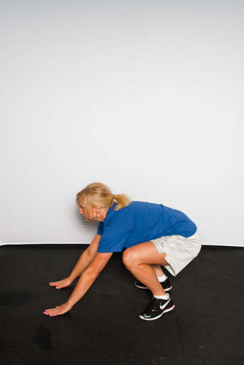 Stand with feet shoulder width apart and arms down at side. With bent knees, fold your waist down, placing hands on the floor in front of feet.