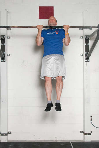 Raise your body up until your shoulders are above the bar.