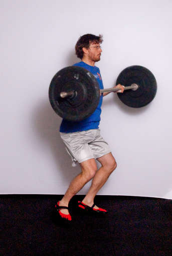 As the bar is moving up, pull your body under the bar by bending and lifting your elbows.