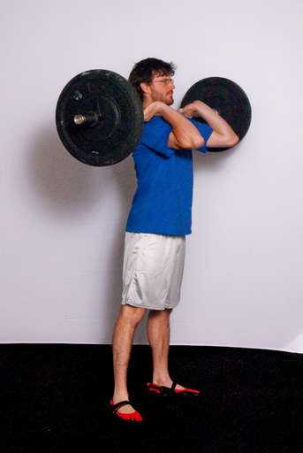 Extend your legs and hips to stand straight up. This concludes the Clean portion of the lift.