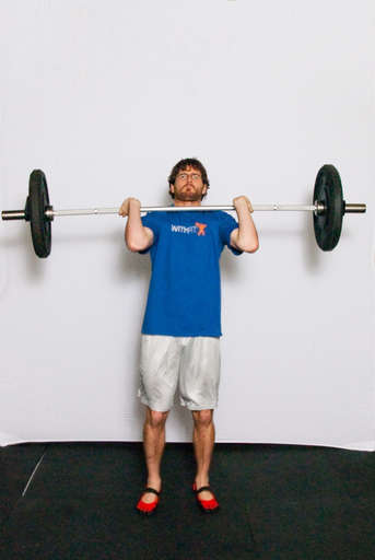 Explosively drive upward with your legs, driving the barbell up off your shoulders.
