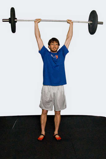 Finish with your body straight and your arms extended over your head.