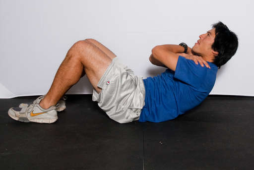 Contract your abdominal muscles, lifting your upper body off the floor.