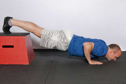 Lower yourself until your chest and chin are touching the floor.