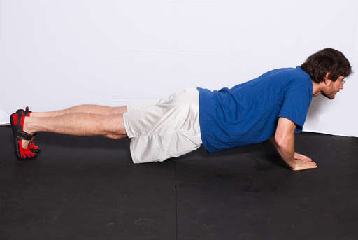 Bend your elbows, lowering your entire body towards the floor. Your body should be in a line, with your back straight.