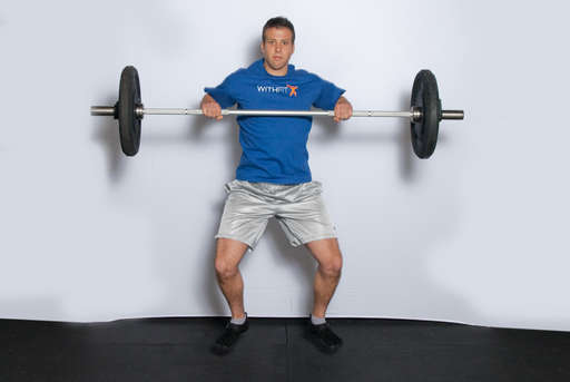 Jump upward, extending your hips and legs. Most of the power for the lift should come from your hips and your jump, not from your arms. As the bar is moving up, pull your body under the bar by bending and lifting your elbows.