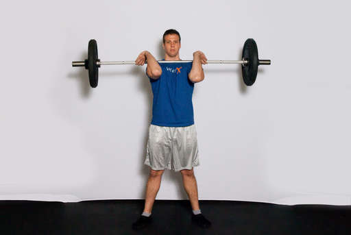 Extend your legs and hips to stand straight up. This exercise should be done as one quick, fluid movement.