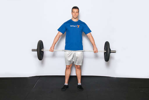 Lift the barbell off the ground by extending your knees and hips until it rests against your body near the middle of your thighs. This is the starting position for this lift.
