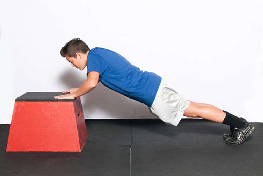 Bend your elbows, lowering your entire body towards the box. Your body should be in a line, with your back straight.