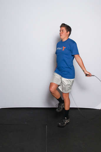 Lift one leg slightly off the ground, so that you are standing on one leg.