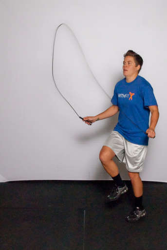 Rotate your wrist so that the jump rope comes over your head and body.