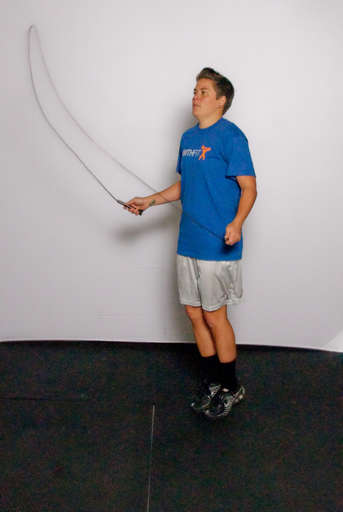 Rotate your wrist so that the jump rope comes over your head.
