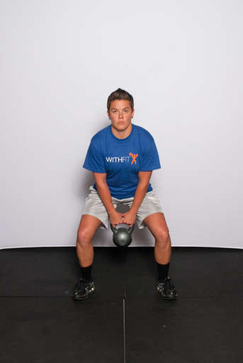 Stand with feet approximately shoulder width apart or slightly wider and grasp the kettlebell with both hands.