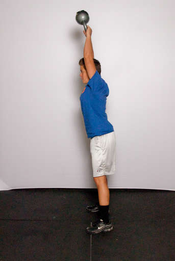 Straighten your hips, stand up and swing your arms up to lift the weight over your head. The power for the lift should come almost completely from the hip extension. Your quads and arms should not be doing much work.