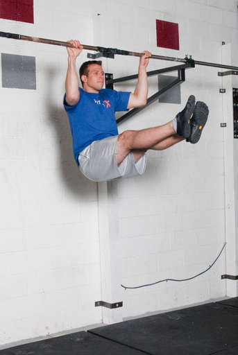 Bend your elbows and pull your chest up towards the bar. Your legs should remain at a 90 degree angle.