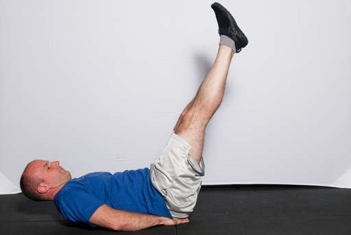 Lower your legs back down in a slow and controlled manner.