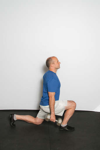 Bend the knee of your front leg until your thigh is parallel with the ground as you also bend the back leg so that the knee comes down towards the ground. The back leg should be balanced on the toes.