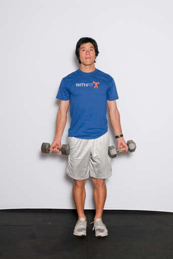 Hold a dumbbell in one hand so the dumbbell is resting in the palm of your hand. Let your arms hang at your sides.