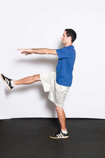 Lift your non-squatting leg up, bending it at the knee slightly.