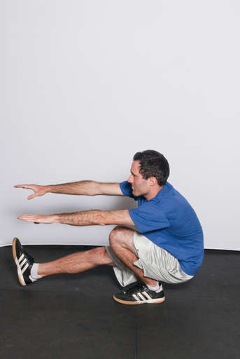Continue to lower your body until your thighs are parallel to the floor.