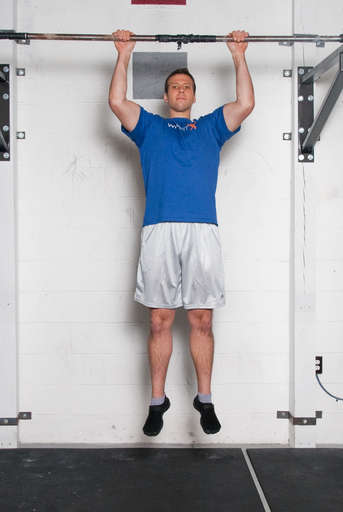 Bend your elbows and pull your chest up towards the bar. Your legs should remain still.