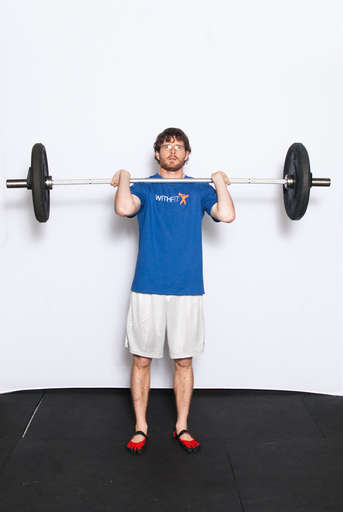 Stand straight while holding a barbell at chest level, keeping the back of your hands against your chest.