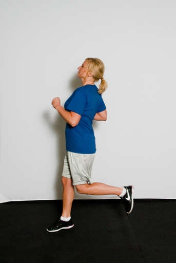 Take a step backwards with one leg as you begin to pump your arms.