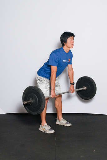 Extend your hips to lift the weight off the ground.