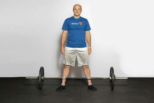 Stand in a wide stance, with your feet wider that shoulder width and toes angled slightly outwards.
