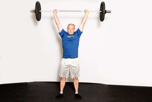 Continue extending until your arms are straight and the weight is overhead.