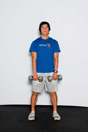Stand with your feet shoulder width apart grasping the weights down in front of you with an overhand grip.