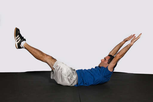 Lift your upper body off the floor at the same time you lift your legs straight off the floor.