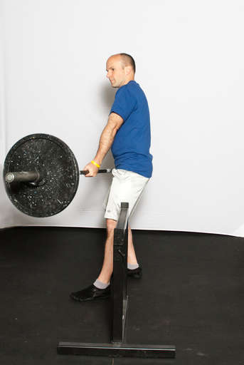 Move the weighted end to the other side of the obstacle. You may have to step out to the side with your front foot.