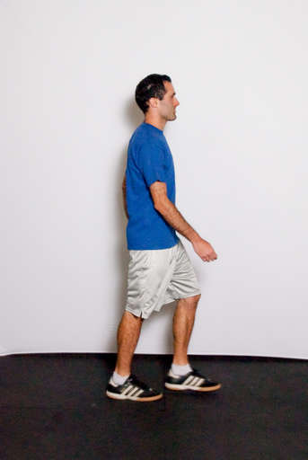 Take a step forward with one leg landing on the heel of your foot.