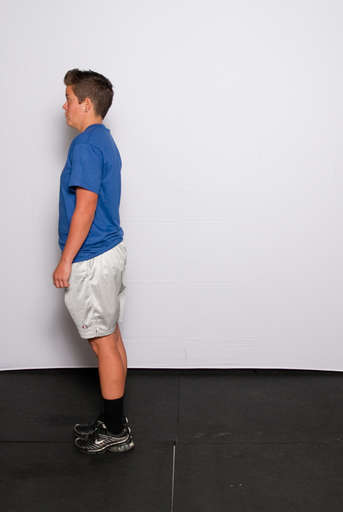 Extend your front leg to raise your body back to a standing position.