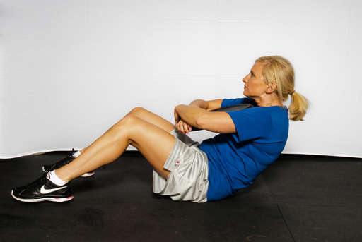 Lift your upper body off the floor by contracting your abdominal muscles.