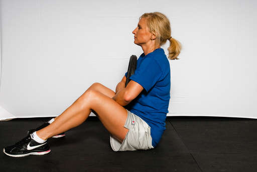 Continue lifting your upper body until you are sitting straight up.