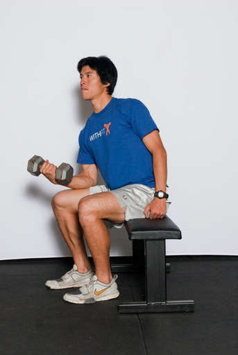 Flex your wrists up as far as the can go, curling the weight up.