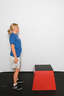 Stand approximately 1 foot away from the box with your legs shoulder-width apart and with a slight bend in the knee. Your arms should hang loosely by your sides.