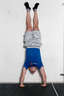 Kick your legs into the air and get into a handstand position.