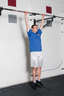 Grasp the pull up bar with an overhead grip, with your hands over the bar and approximately shoulder width apart. Hang from the pull up bar, so that your arms are completely straight.
