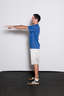 Stand with your feet approximately shoulder width apart and your hands on your hips or extended out in front of you.
