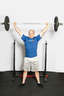 Hold the barbell above your head using a wide grip, keeping elbows locked. Your head should be forward of the bar.