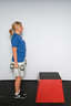 Stand facing a box. Hold the dumbbells in your hand.